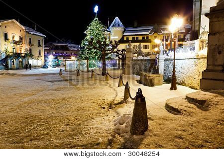 Illuminated Christmas Tree On Central Square Of Megeve In French Alps
