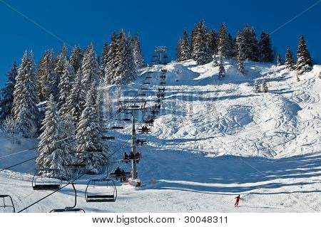 Riding The Chairlift In French Alps