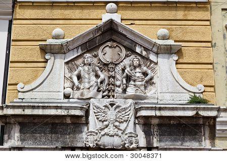 Relief With Two Men On Yellow Building In Rijeka, Croatia