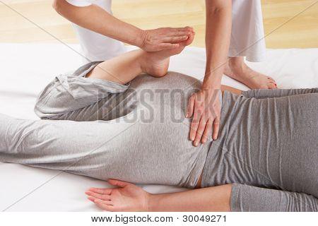 Woman having Shiatsu massage