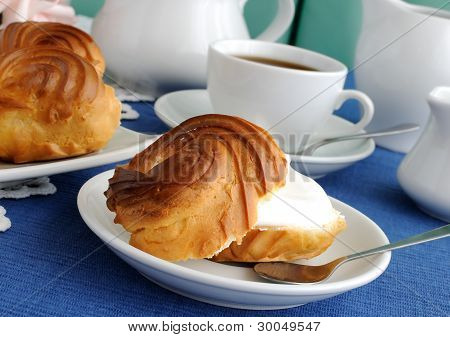 Eclairs With A Cup Of Coffee