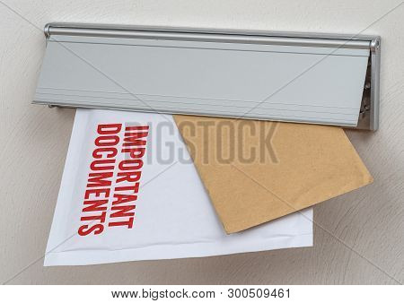 A Letter Labeled Important Documents In A Mail Slot