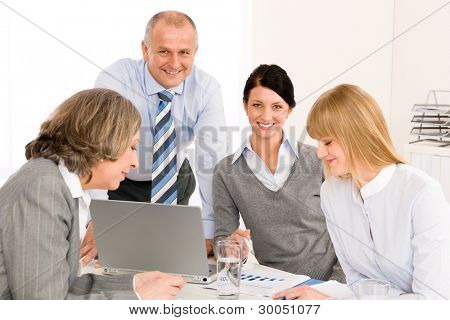 Business team meeting executive businessman with happy colleagues in office