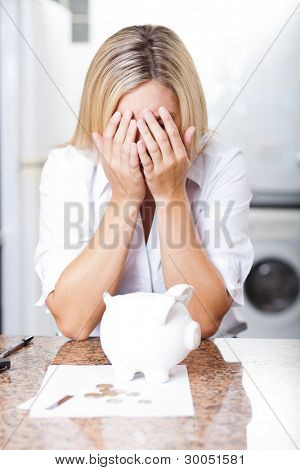 unhappy young woman having financial trouble