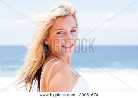 cheerful young woman over sea view background