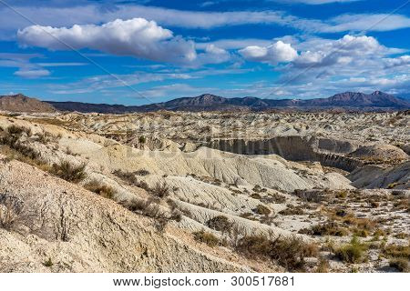 The Badlands of Abanilla and Mahoya near Murcia in Spain is an area where a lunar landscape has been formed by the erosive force of water over the millennia. poster