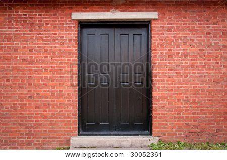 Black Door on Brick Exterior