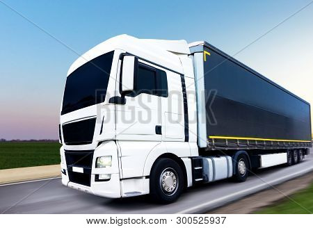 Container Of Road Cargo Transportation. Commercial Transport. The White Truck On The Road