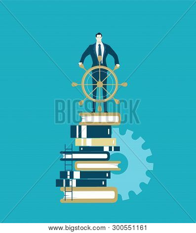 Businessman With The Ship Wheel Stands On The Pile Of Books. Leader, Director, Manager, Front Man Id