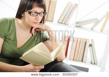Bright Picture Of Young Woman Woman With Book , Bookshelf On Background