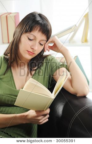 Portrait Of A  Young Woman Woman With Book , Bookshelf On Background