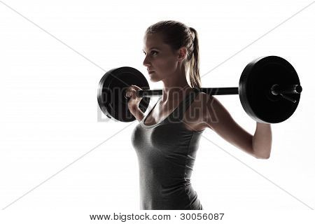 Frau anhebende Gewichte