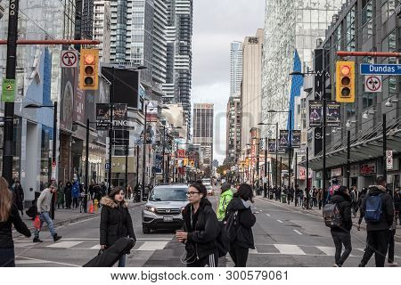 Toronto, Ontario - November 13, 2018: Skyscrapers On Yonge Street, On Yonge Dundas Square, With Peop
