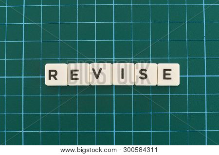 Revise Word Made Of Square Letter Word On Green Square Mat Background.