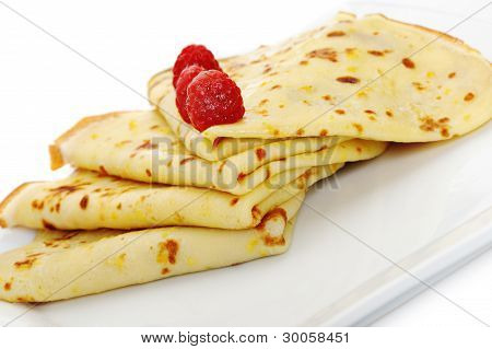 Crepe On A Plate With A Raspberry