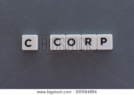 C Corp Word Made Of Square Letter Word On Grey Background.