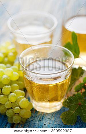 White wine in rustic glasses