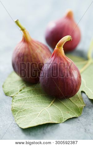 Fresh figs on figs leaves