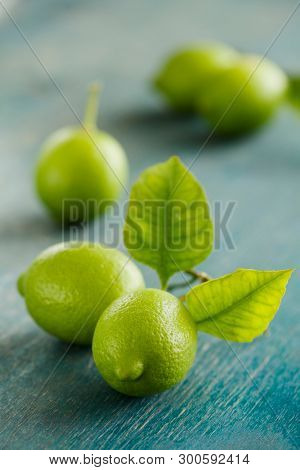 Fresh limes on a wooden table