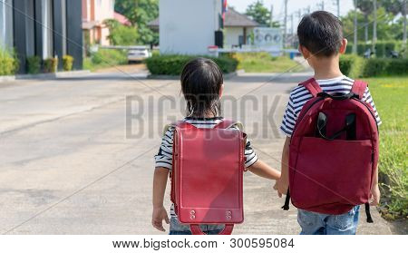 Happy Smiling Kid In Glasses Is Going To School For The First Time. Child Boy With Bag Go To Element