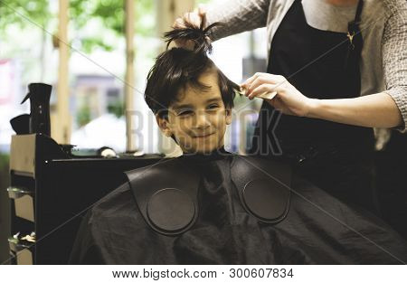 Hairdressers Hands Making Hairstyle To Child Little Boy In The Barber Shop Hair Cut Professional - L