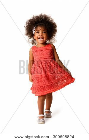 Full Length Portrait Of Cheerful African American Little Girl In Dress Of The Color Of The Year 2019