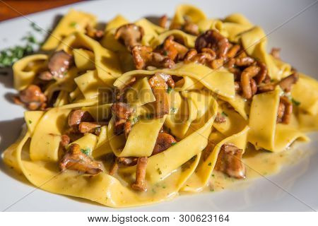 Fettuccine Alfredo With Mushrooms In Italian Restaurant