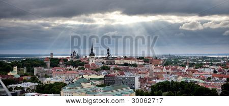 Panorama of Tallinn Old Town with a sunlight through clouds