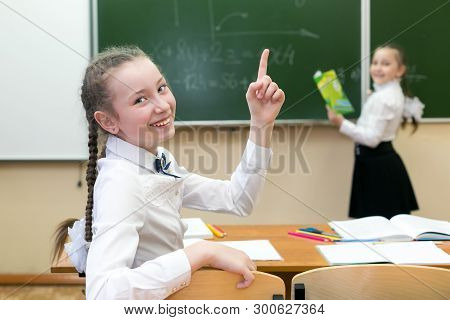 Schoolgirl Had The Idea Of The Right Answer. Girl Schoolgirl Rejoices That He Knows The Correct Answ