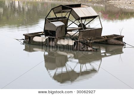 Metal wheel of watermill in Pond use for Add Oxygen for Industrial Sewerage System and water Treatment