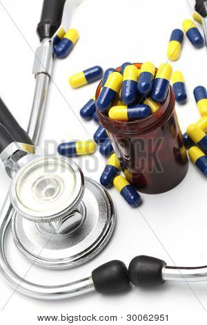 Perspective of Medical Stethoscope and Capsule on white background for Healthy Concept