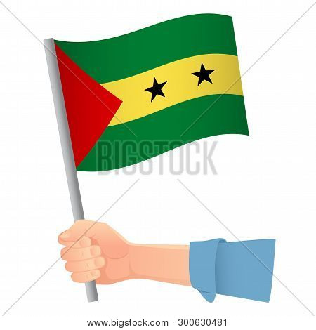 Sao Tome And Principe Flag In Hand. Patriotic Background. National Flag Of Sao Tome And Principe Vec