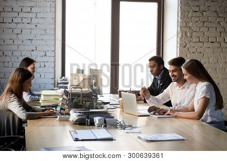 Five Multiracial Coworkers Having Busy Working Day At Coworking Room