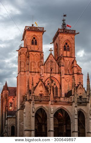 Ancient Monumental Church Of Semur En Auxois In France At Sunset