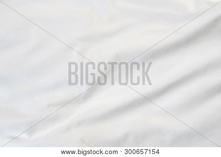 Texture Of White Blanket Crumpled On The Bed