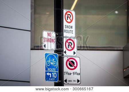 North American No Parking Signs And A Roadsign Indicating A Bike Lane Abiding By North American Stan