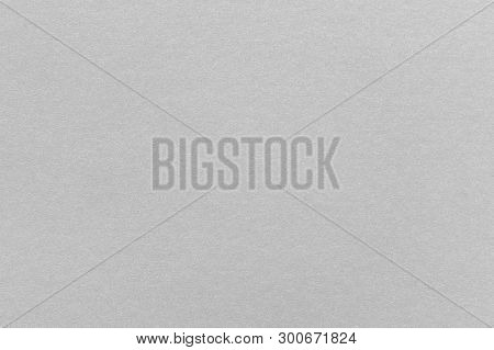 Abstract Grey Glossy Paper Texture Background Or Backdrop. Empty Gray Cardboard Or Shiny Paperboard