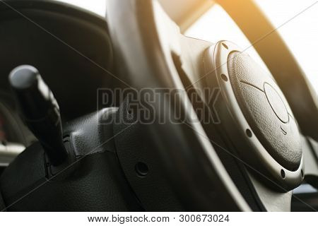 Close Up Image Of Racing Performace Steering Wheel And Horn In Black Colour.