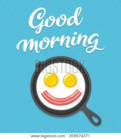 Good Morning Text Lettering And Breakfast Illustration With Smiling Fried Eggs And Bacon On Skillet.