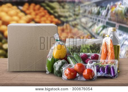 Online Grocery Concept. Shopping Order Online Ingredients Food For Cooking And Packages Box With Bla