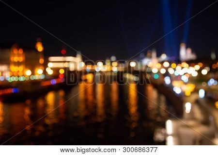 Abstract City Lights Background. Defocused Urban Background At Night