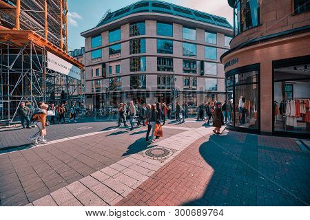 Duesseldorf, Germany - May 11, 2019: Unidentified Visitors And Shopers Pupulate The Place In Front O