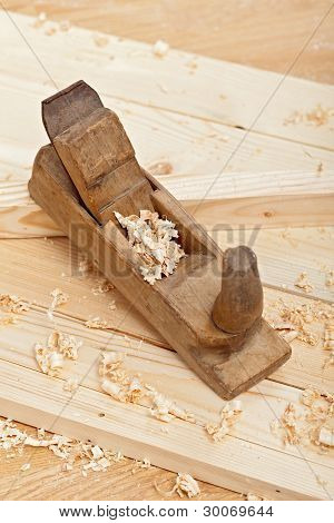 Wood Plancks, Plane And Wooden Shavings