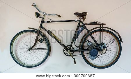 Vintage Soviet Bicycle With An Outboard Motor On Isolated White Background. Speed Of The Bike Up To