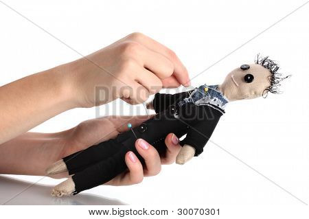 Voodoo doll boy-groom in the hands of women isolated on white
