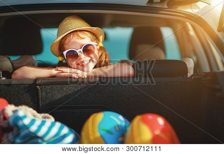 Happy Child Girl In Car Going On A Summer Vacation Trip