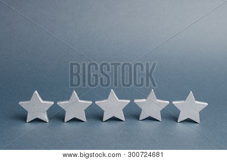 Five Stars On A Gray Background. Success In Business. The Concept Of Rating And Evaluation. The Rati