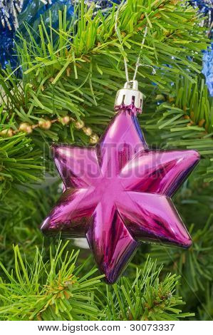 The Christmas-tree Decoration In The Form Of Six-final Purpur Star.