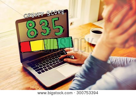 Excellent Credit Score Theme With Man Using A Laptop Computer