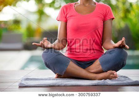 Yoga meditation in lotus pose, female doing yoga in nature